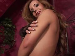 Curvy busty milf stimulates her fake tits and starving pussy