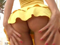 Sweetie in a sexy yellow costume masturbates nicely on the stairs